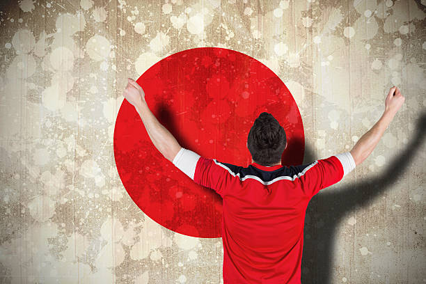 Excited football fan cheering Composite image of excited football fan cheering against japan flag sopaatervinning stock pictures, royalty-free photos & images