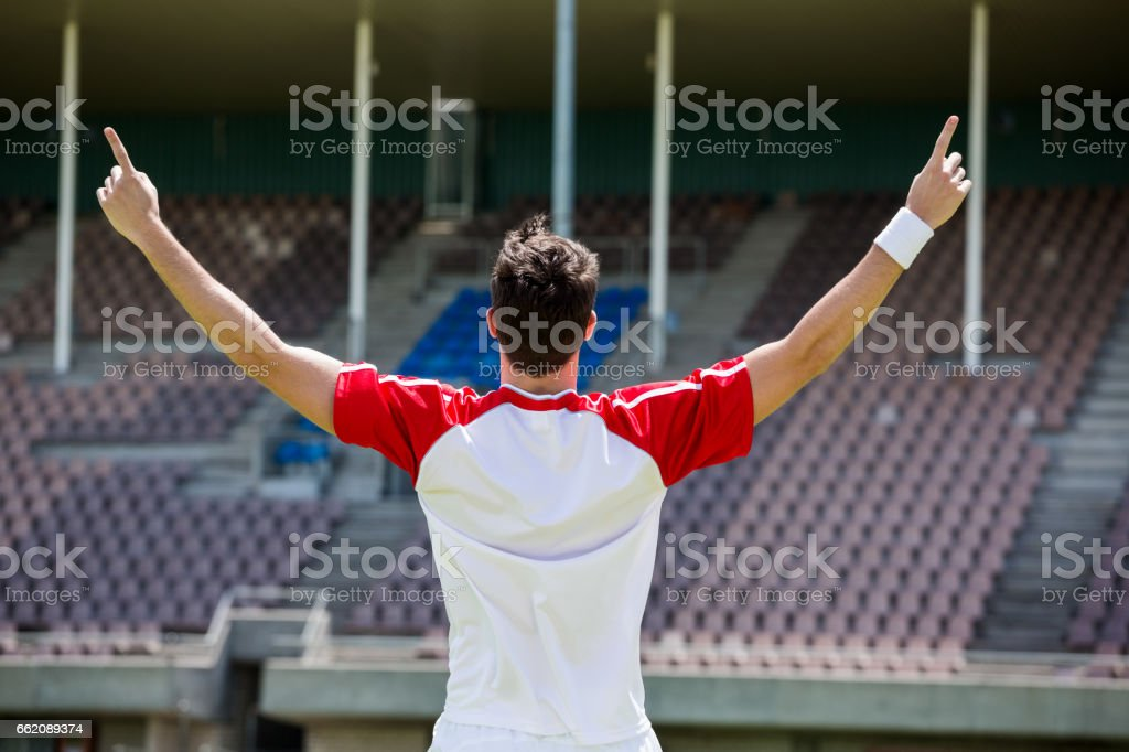 Excited football player standing in stadium royalty-free stock photo