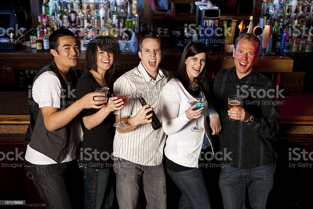 Excited Friends at a Bar royalty-free stock photo