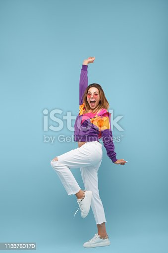 istock Excited funky woman looking at camera 1133760170