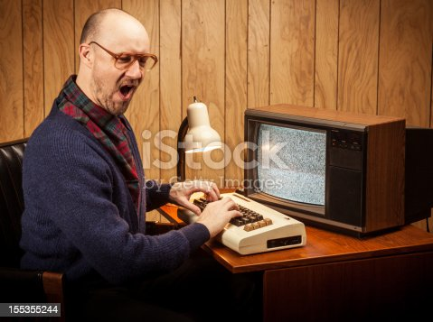 618210072 istock photo Excited Geeky Nerd Computer Science work man vintage style 155355244
