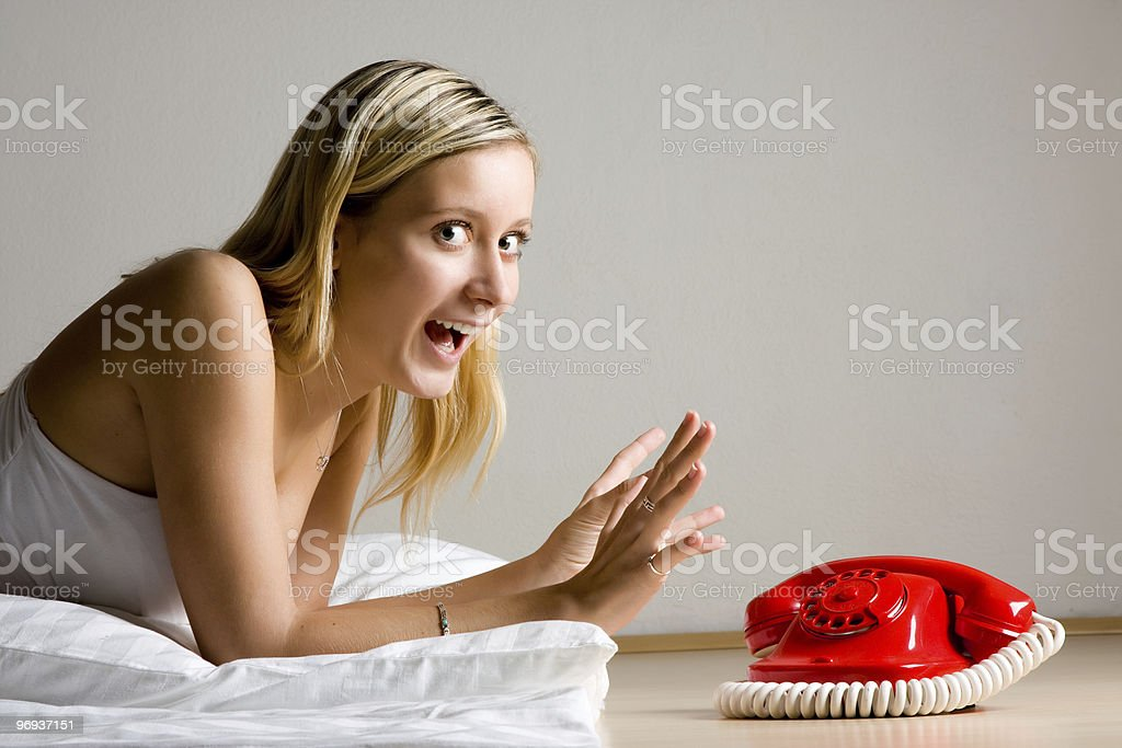 Excited Girl By Red Telephone royalty-free stock photo