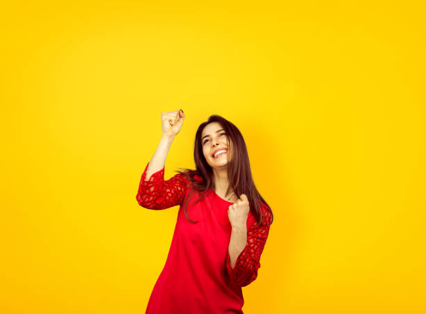 Excited girl raising hands in success stock photo