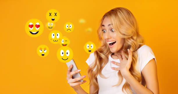 excited girl watching social media live stream - excited emoji stock photos and pictures
