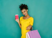 istock Excited girl with shopping bags and take away drink 892118354