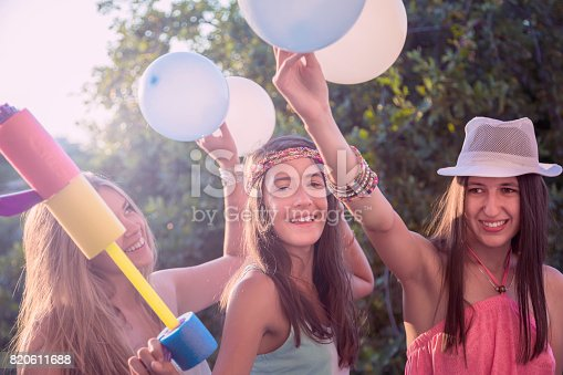 istock Excited girls on a party 820611688