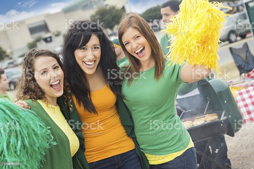 Excited group of college sports fans cheering at tailgate party royalty-free stock photo