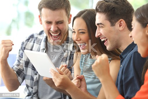 493712130 istock photo Excited group of friends watching tv from tablet 638891478