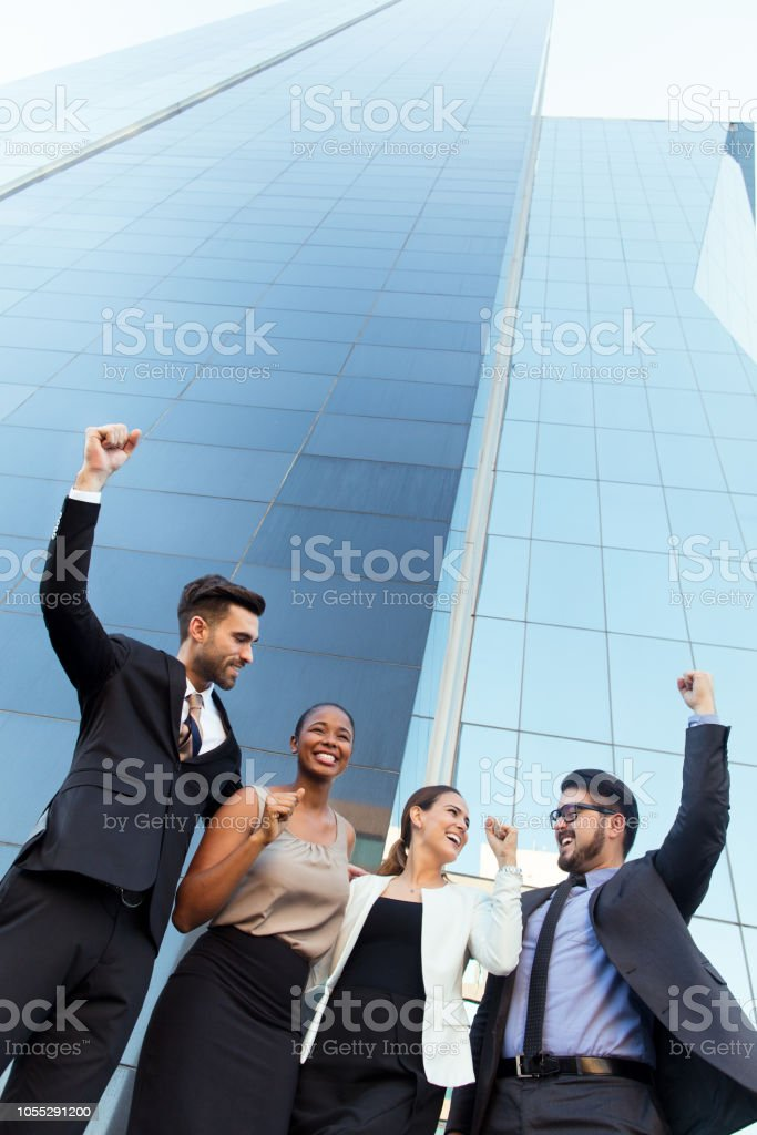 Excited group of latin business executives outside stock photo