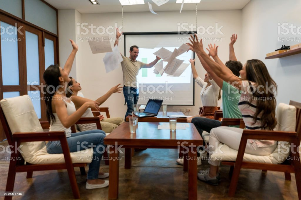 Excited group of people celebraing their success in a business...