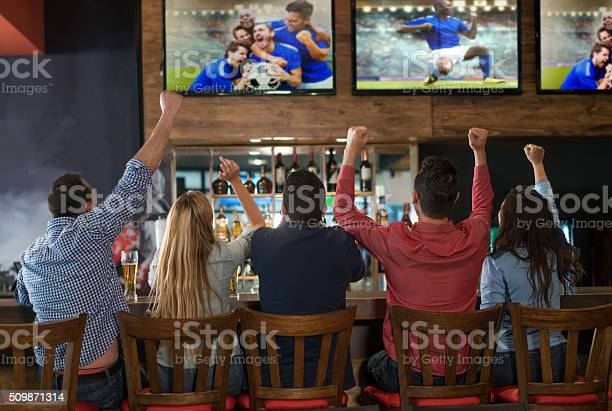 Excited group of people watching the game at a bar picture id509871314?b=1&k=6&m=509871314&s=612x612&h=f8eqakzycf2msgjj0vfibcjyckduvldf8 l vqckge4=
