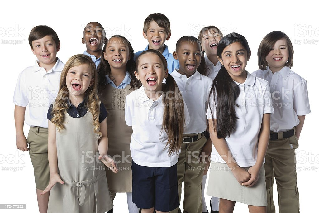 Excited group of private school students wearing uniforms stock photo