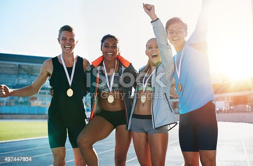 istock Excited group of runners with medals 497447934