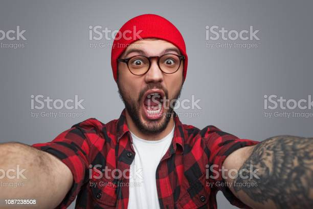 Excited handsome man taking selfie in studio picture id1087238508?b=1&k=6&m=1087238508&s=612x612&h=qdi2tbeml8otblvz fres2vvwmldfnzx5byywqwvzbo=