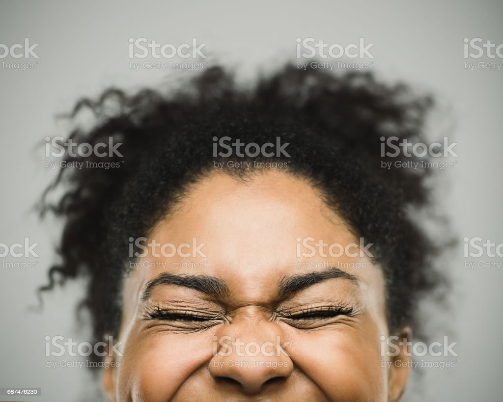 Excited happy afro american woman against gray background stock photo