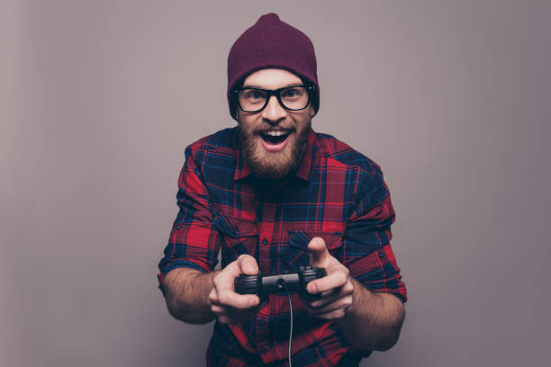 Excited happy hipster man playing video game stock photo