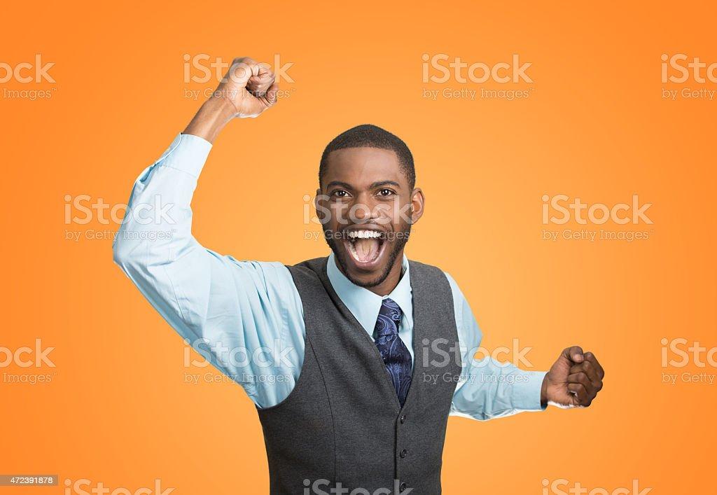 Excited happy man celebrates success, good outcome stock photo