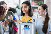 Excited high school student using 3D printer