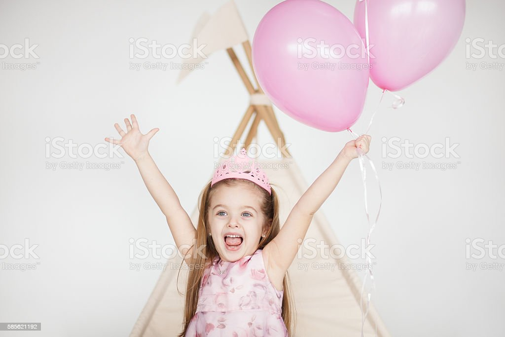 Excited kid celebrating her birthday stock photo