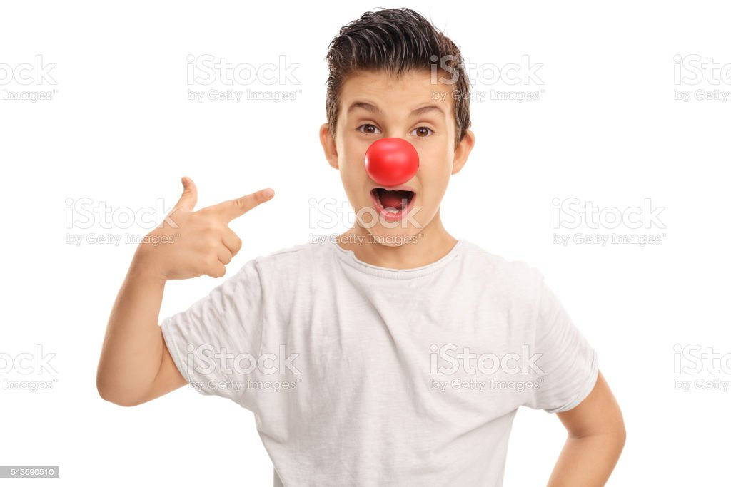 Excited kid with a red clown nose stock photo