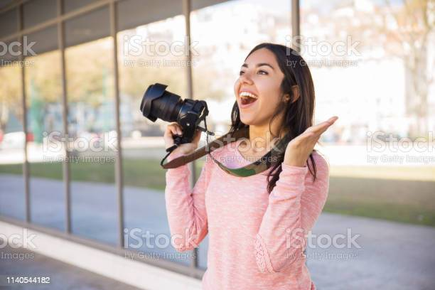 Excited lady taking photos with camera outdoors picture id1140544182?b=1&k=6&m=1140544182&s=612x612&h=urt1jhuypuxaq47jotvulwjgki 3qe976qyyj3ysjv8=