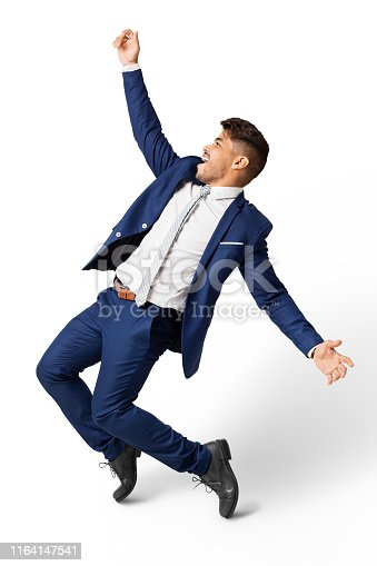 istock Excited Latin Businessman Dancing Over White Studio Background 1164147541