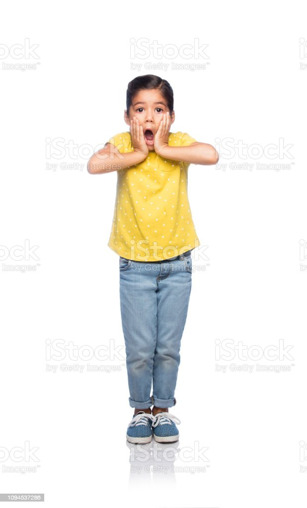Excited latin little girl stock photo