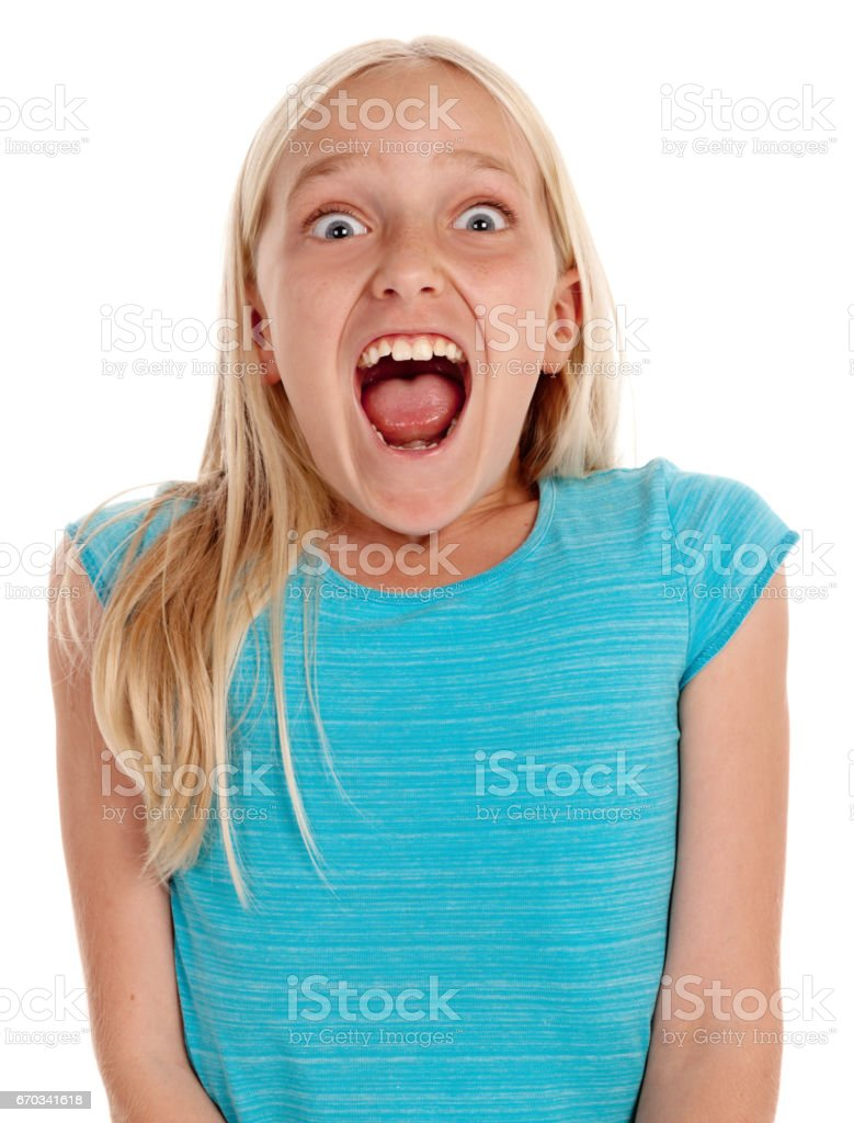 Excited little blonde girl gasps in delight stock photo