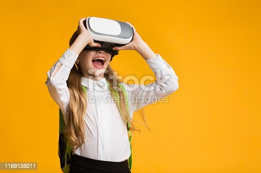 istock Excited Little Girl Experiencing Virtual Reality Using VR Headset 1169135011