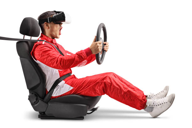 excited male racer in a car wheel holding a steering and wearing vr headset - formula 1 стоковые фото и изображения