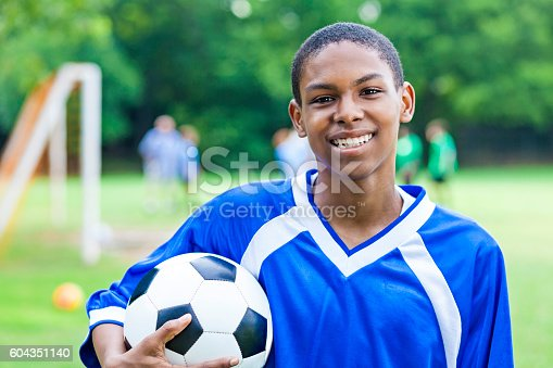 istock Excited male teenage soccer player 604351140