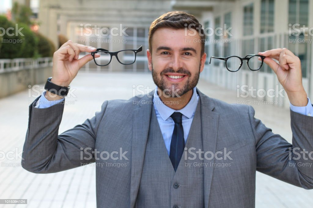 Excited man getting a 2x1 eyeglasses offer stock photo