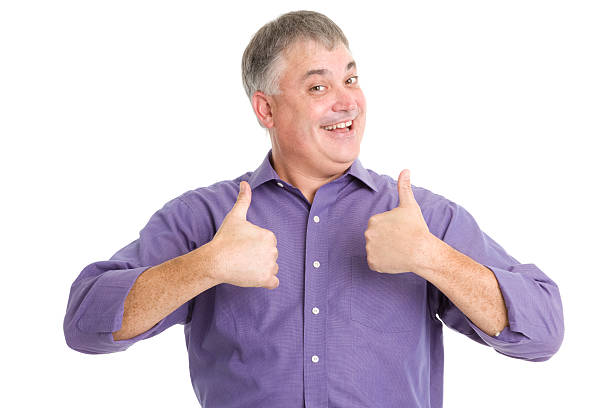 Excited Man Gives Two Thumbs Up Portrait of a mature man on a white background. http://s3.amazonaws.com/drbimages/m/jk.jpg cheesy grin stock pictures, royalty-free photos & images