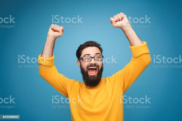 Excited man in yellow holding hands up picture id945088692?b=1&k=6&m=945088692&s=612x612&h=kqpc7u6gyiwsstzyil6eyag vmgfu5kbc4gwlnhgjie=