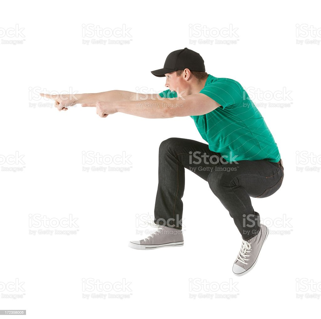 Excited man jumping and pointing royalty-free stock photo