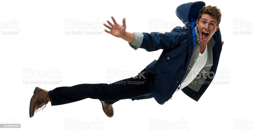 Excited man jumping and shouting stock photo