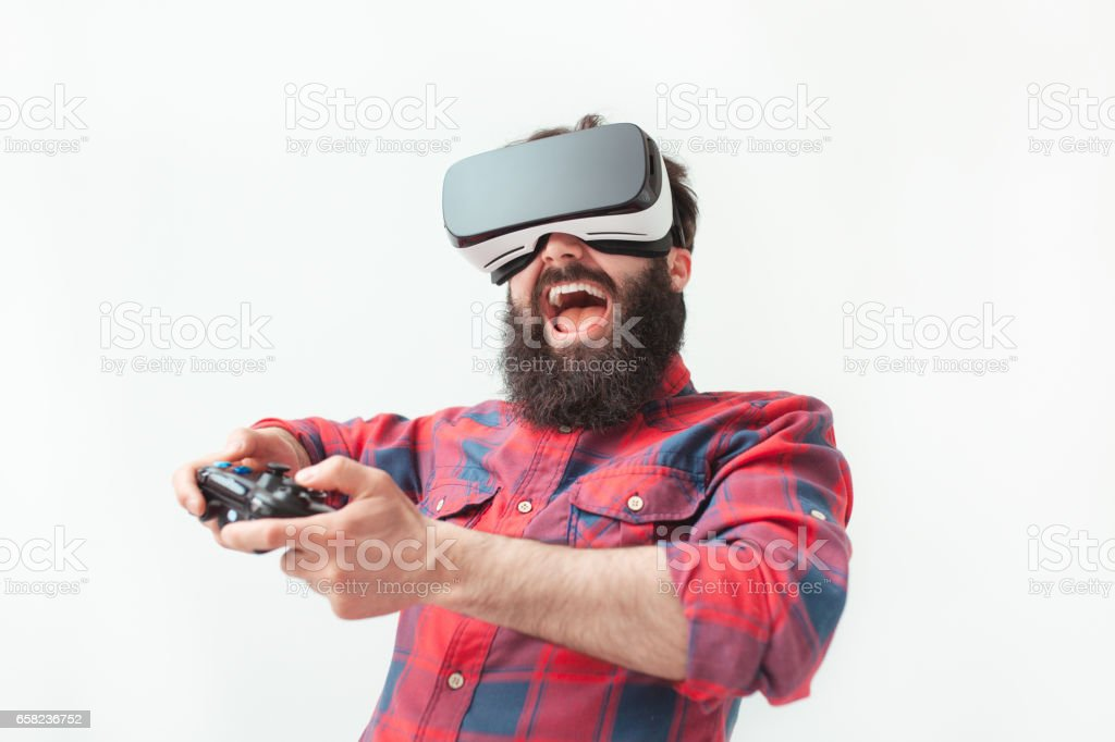 Excited man playing a VR game stock photo