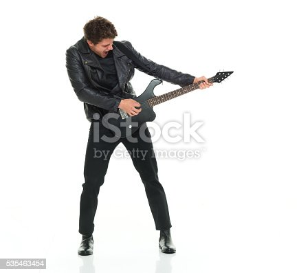 istock Excited man playing guitar 535463454