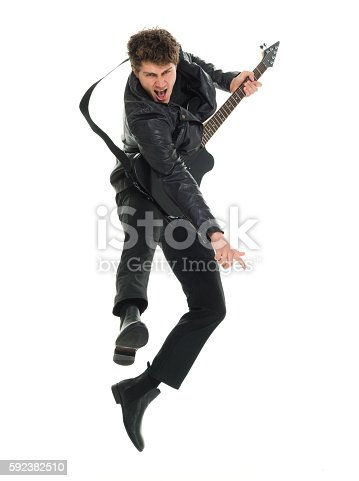 istock Excited man playing guitar 592382510