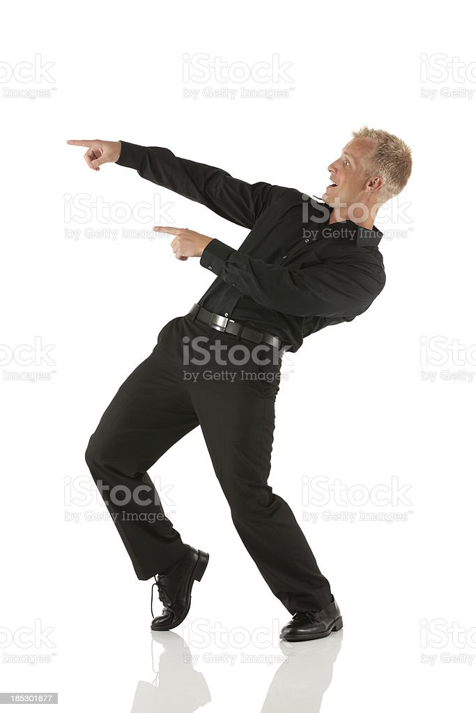Excited man pointing stock photo