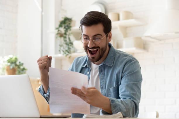 Excited man reading postal mail letter overjoyed by good news picture id1197547558?b=1&k=6&m=1197547558&s=612x612&w=0&h=rqka4akldsdxoiralam3yvroyfg9 5gskhr7zxgo9xu=