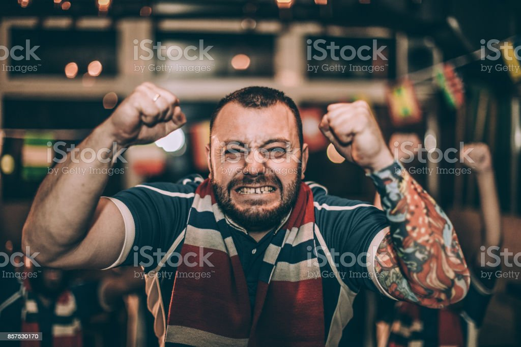 Excited man watching a game stock photo