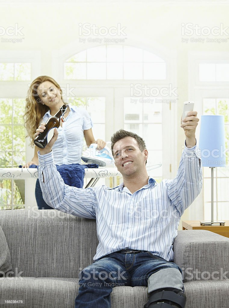 Excited man watching TV royalty-free stock photo