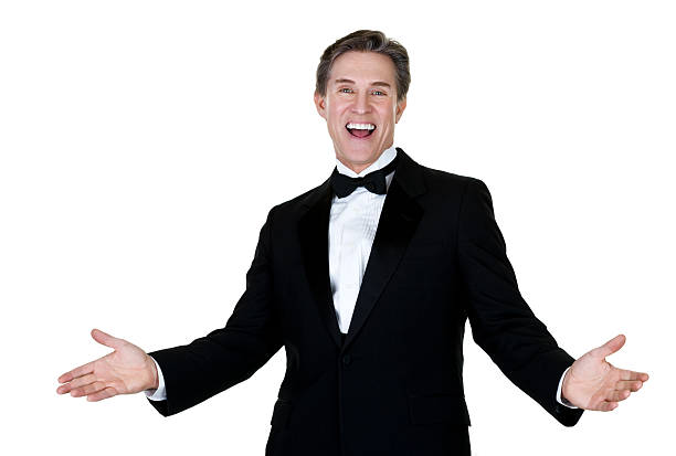 Excited man wearing a tuxedo Waist up composition of a mature man with an excited expression wearing a tuxedo and isolated on white background  tuxedo stock pictures, royalty-free photos & images