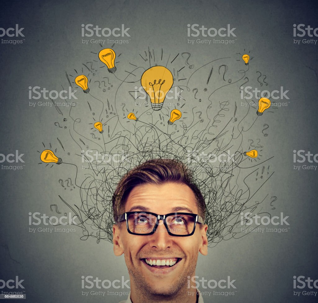Excited man with many ideas light bulbs above head looking up – zdjęcie