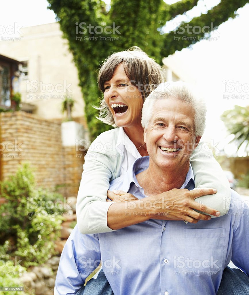 Excited mature couple having fun royalty-free stock photo