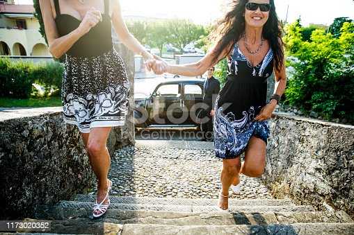 Excited Mature couple rushing upstairs to the small Chapel