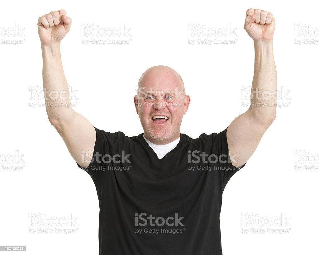 Excited Mature Man Raises Fists stock photo
