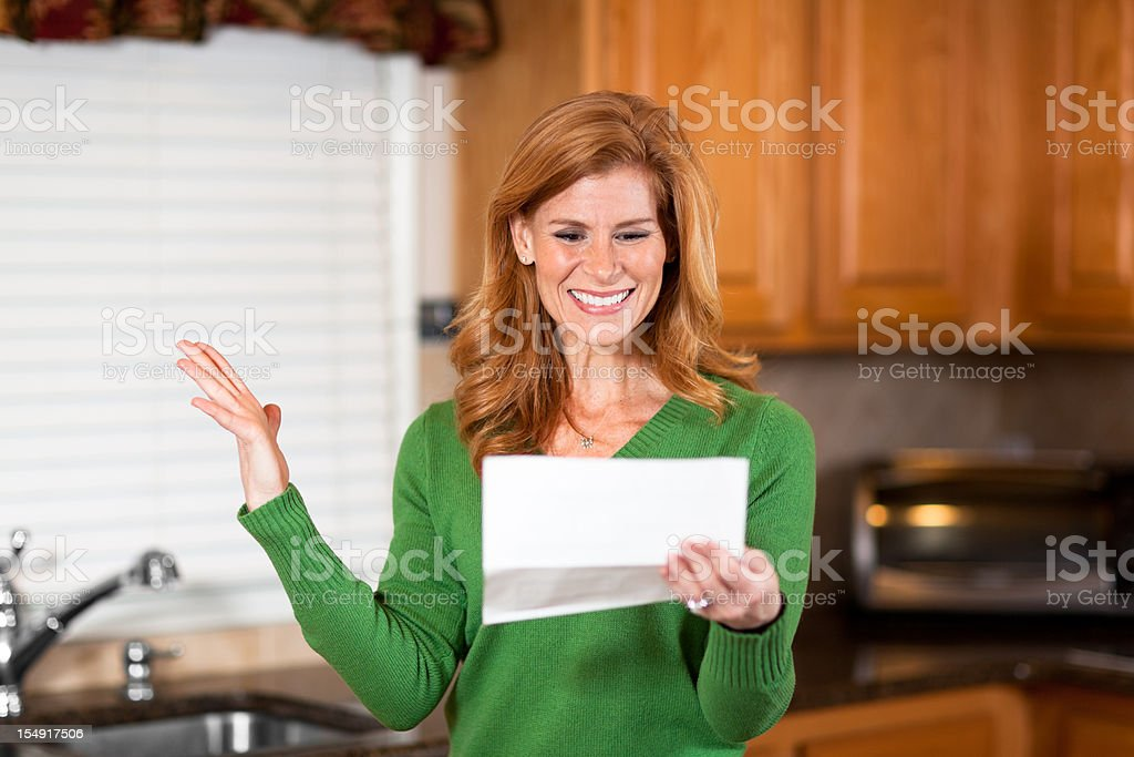 Excited mature woman with raised hand reading statement royalty-free stock photo