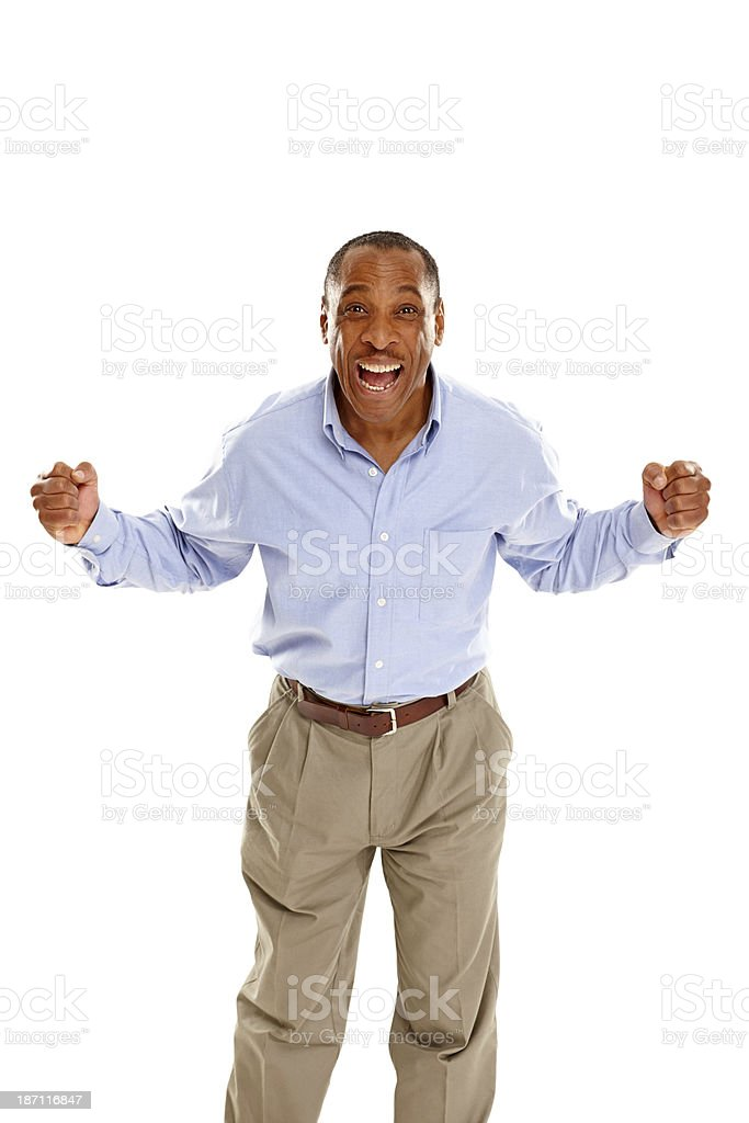 Excited middle aged african guy cheering royalty-free stock photo
